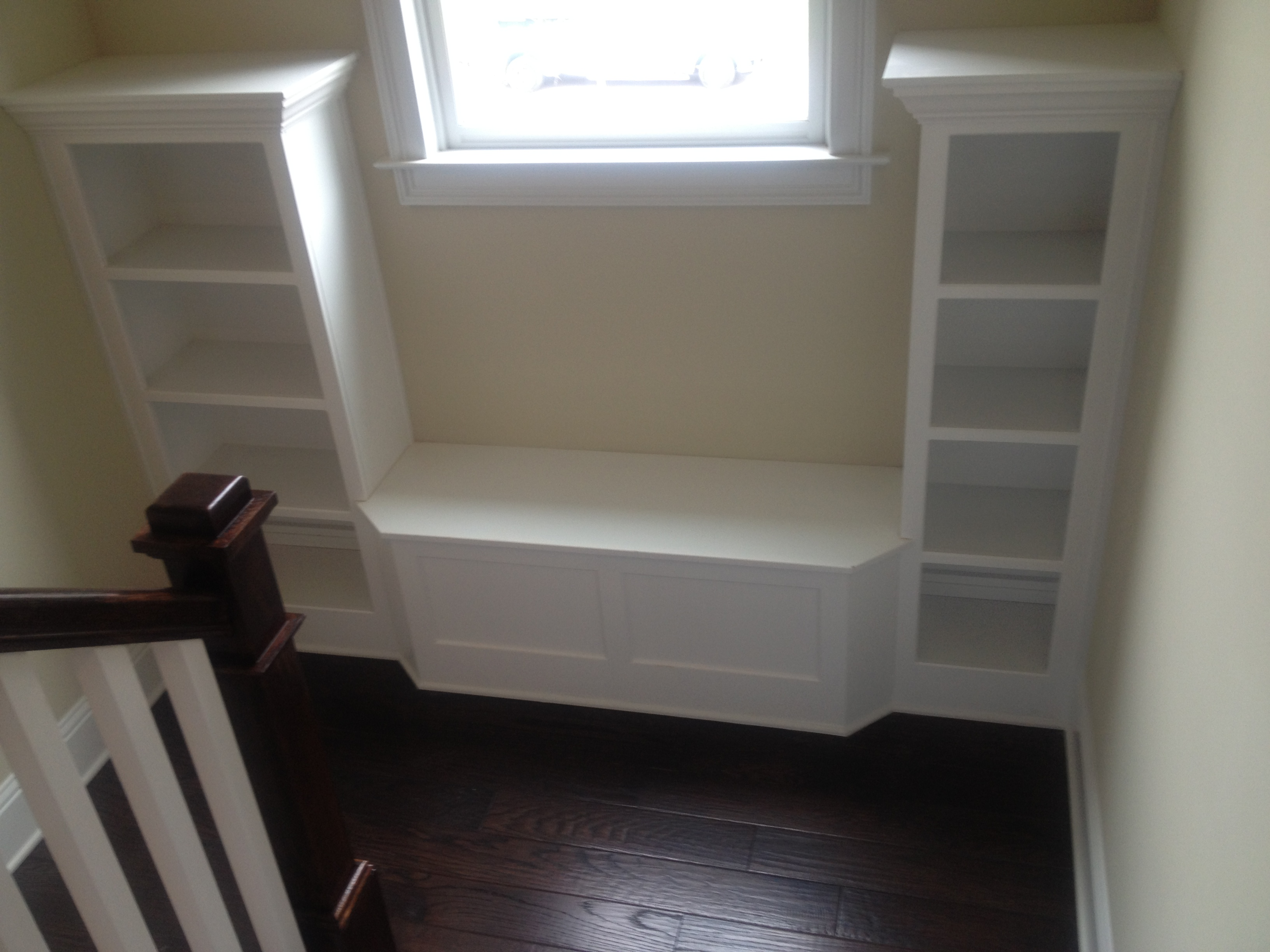 Stairway landing Bookcase and Window Seat in Brookhaven, GA